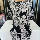 Шикарное фирменное платье. По бирке 10р.не ношеное.