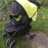 Прогулочная коляска. В комплекте чехол на ножки, дождевик,сумка для мамы