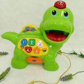 Развивающая игрушка музыкальный динозаврик от Vtech на немецком языке