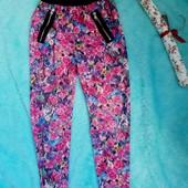 Красивые штаны в розах на девочку 7-9 лет