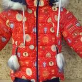Яркий и теплый зимний комбинезон для девочки.