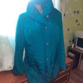 Брендовая тёплая куртка на шикарные формы.