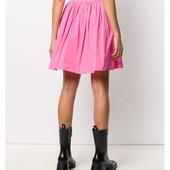 Короткая ,слегка расклешенная юбка из ткани с легким блеском/весна/лето