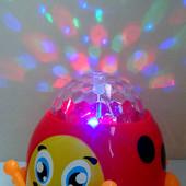 Классная Божья Коровка --- со световыми и звуковыми эффектами.Ездит от батареек