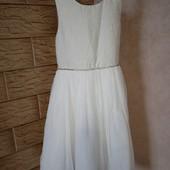Фірмове,дуже гарне,нове плаття на дівчинку 9-10р.Дуже нарядне!